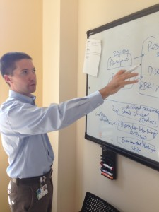 Dr. Jared Odegard diagrams the BRI's information sharing systems.