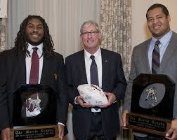 2013 Morris Trophy winners Will Sutton from ASU and Xavier Su'a Filo from UCLA with Morris Trophy board member and former UW Quarterback Tim Cowan